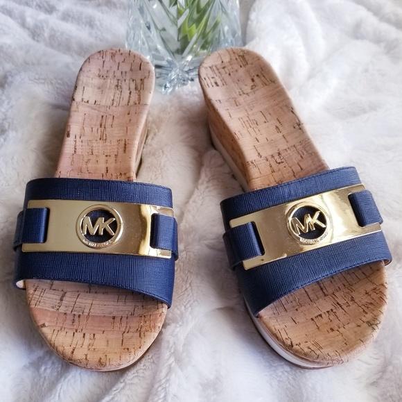 1a93e621ff Michael Kors Warren Platform Wedge Sandals. M_5ae626049a9455bb207e9cfb